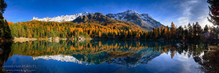 Panorama Val Camp Seespiegelung Herbstwald